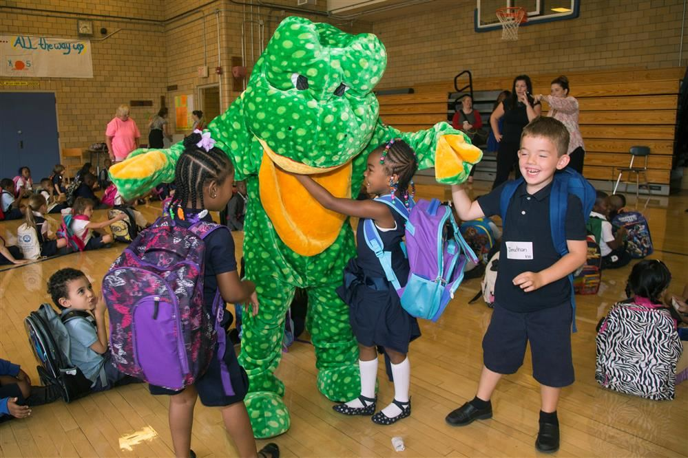Reddy Freddy Frog with a group of young students in gym