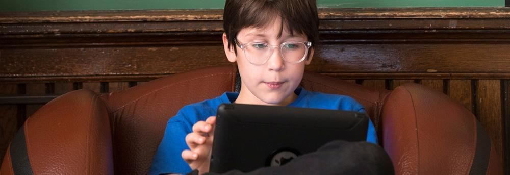 male student on tablet