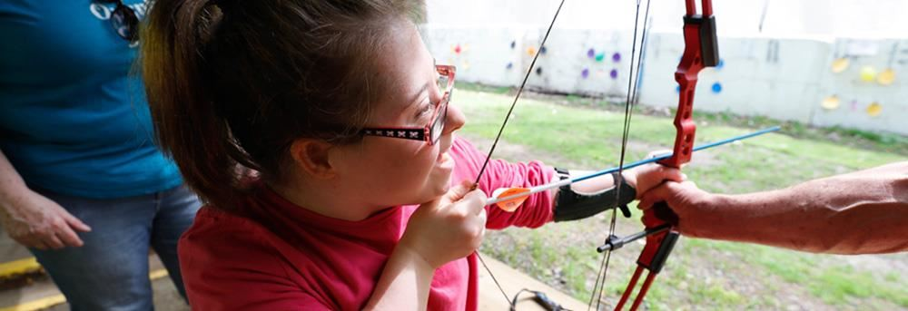 Pioner student learning archery