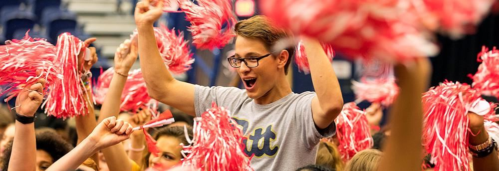 male student cheering during senior signing day