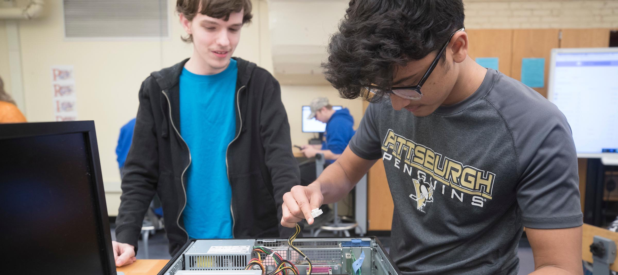 Students in Technology classroom working on a computer