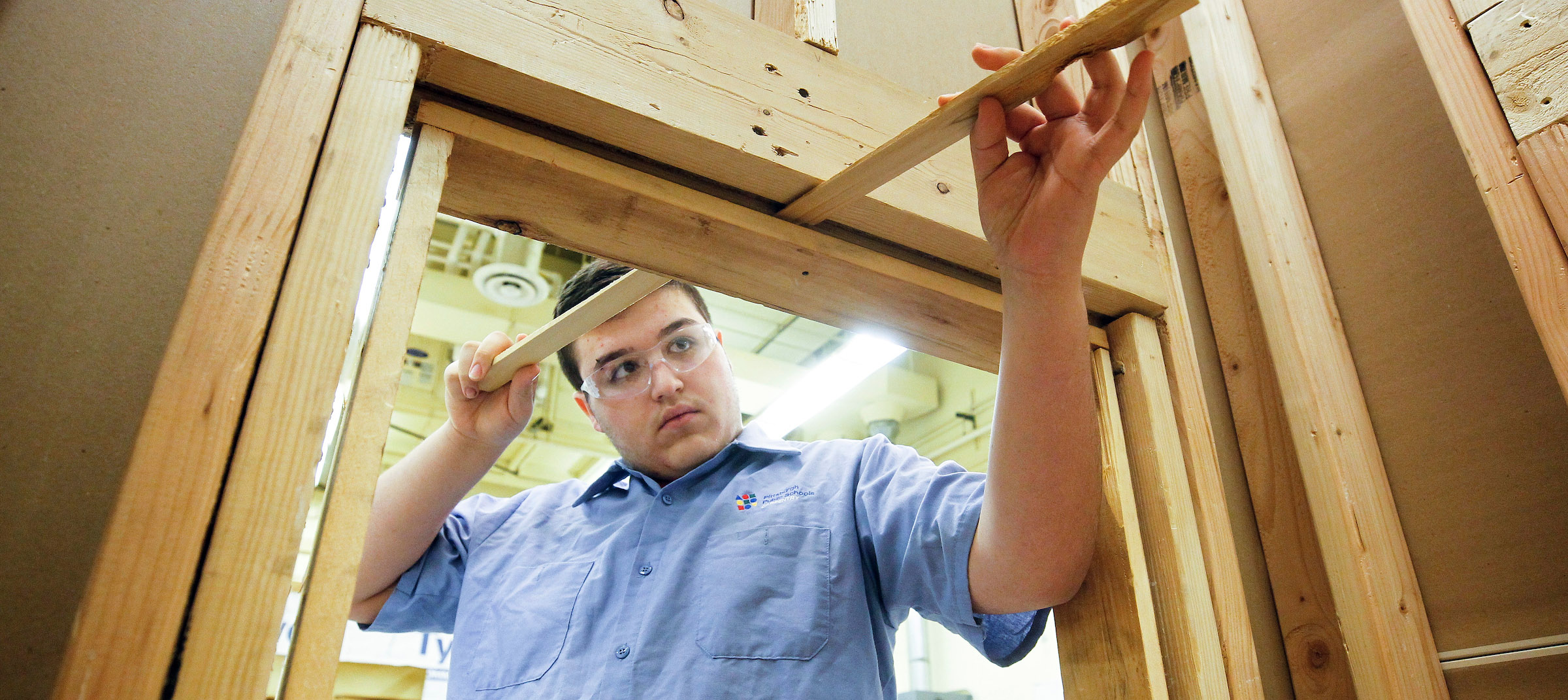 Student in classroom building window structure