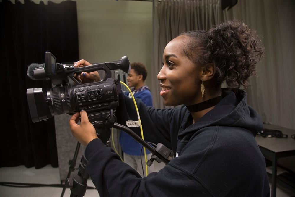 Student behind camera filming Expect Great Things TV