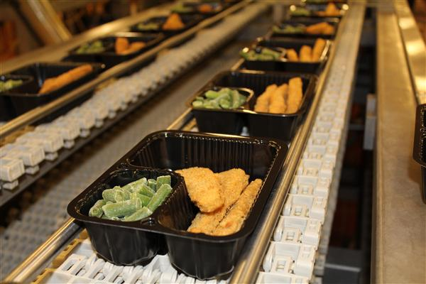 Chicken Tenders And Green Beans Cruise Down The Line At The Central Kitchen  Facility On The